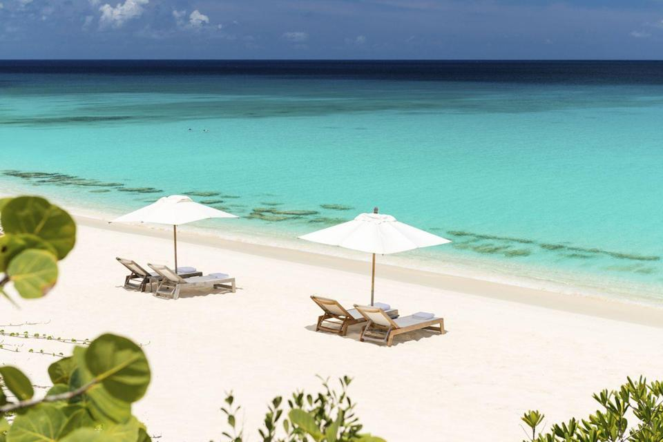 """<p>It's hard not to have a deep love affair with Aman on the whole, as each and every one of their properties exudes warmth, luxury and sophistication, always seamlessly syncing with their natural surroundings. <a rel=""""nofollow noopener"""" href=""""https://www.aman.com/resorts/amanyara"""" target=""""_blank"""" data-ylk=""""slk:Amanyara"""" class=""""link rapid-noclick-resp"""">Amanyara</a>, set on the secluded turquoise Western coast of Turks and Caicos, is home to some of the best white-sand beaches in the world. </p><p>Whether taking in the view from their dazzling infinity pool, wading into the gentle lapping waves on their private stretch of coastline, or snorkeling in the colorful Caribbean reefs, Amanyara is special because views are enriched with the architecturally innovative creation of the property. Each and every villa at Amanyara offers a different view–our favorites include Villa 30's stretch of rocky coastline and never-ending turquoise waters, and the cove and caves tucked behind room #124. However, some of the best views at Amanyara are taken in from the intimate window seats inside the bar, a perfect place to enjoy sundowners and watch the sun set over the azure blue pool and oceans beyond. And hey, close proximity to the bar itself is never a bad thing.</p>"""