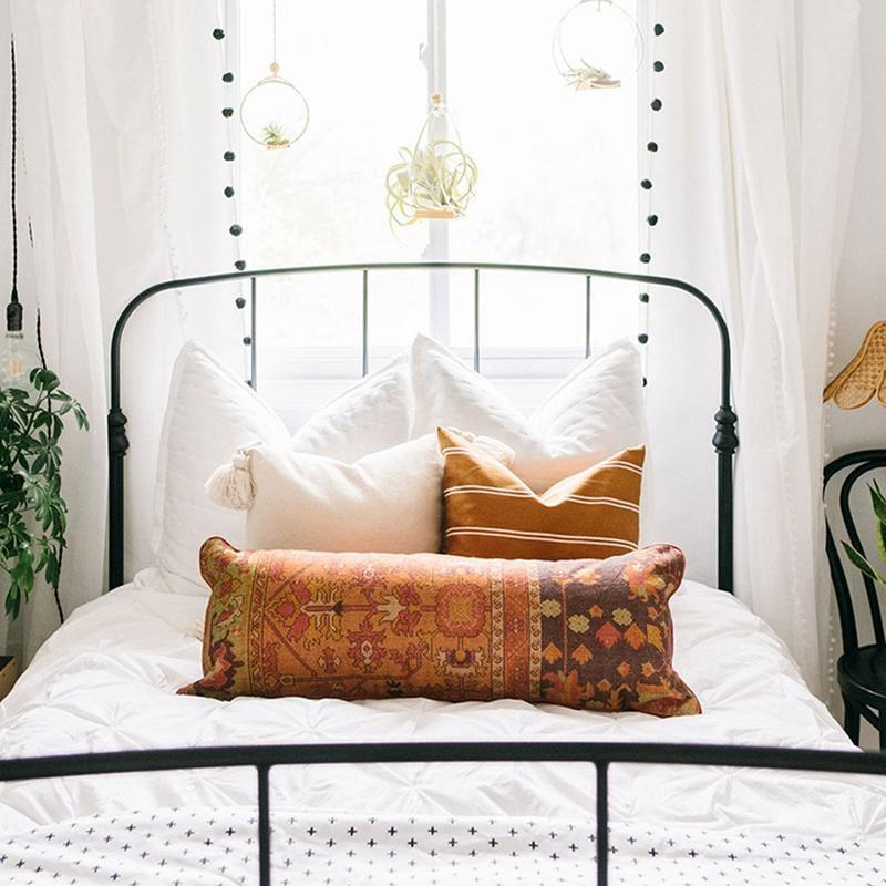 """<p>""""The easiest way to update your home for fall is with some seasonal pillows. This new <span>Junglaow Justina Blakeney X Loloi Moho Lumbar Pillow</span> ($89) will be the perfect addition to my bedroom."""" - MCW</p>"""