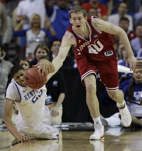 Indiana's Cody Zeller and Kentucky's Anthony Davis vie for a lose ball during the first half of an NCAA tournament South Regional semifinal college basketball game Friday, March 23, 2012, in Atlanta. (AP Photo/David J. Phillip)