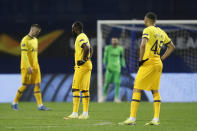 Tottenham Hotspur players react after Dinamo Zagreb's Mislav Orsic scores his side's third goal during the Europa League round of 16 second leg soccer match between Dinamo Zagreb and Tottenham Hotspur at the Maksimir stadium in Zagreb, Croatia, March 18, 2021. (AP Photo/Darko Bandic)