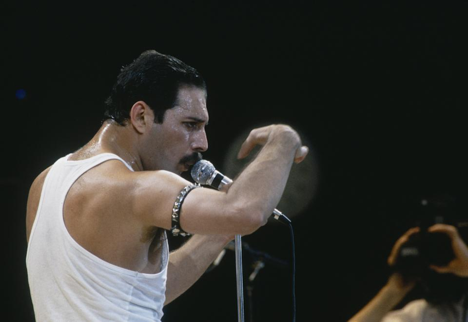 Singer Freddie Mercury of Queen performs during Live Aid at Wembley Stadium on 13 July 1985. (Photo by Dave Hogan/Getty Images)