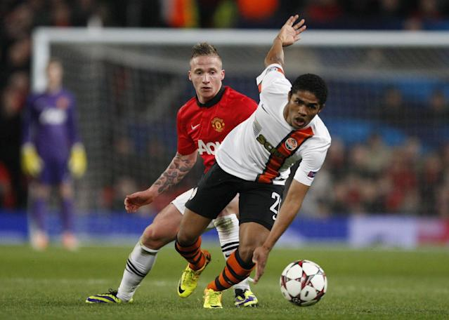 FILE - In this Tuesday, Dec. 10, 2013 file photo, Donetsk's Douglas Costa, right, gets away from Manchester United's Alexander Buttner during their Champions League group A soccer match between Manchester United and Shakhtar Donetsk at Old Trafford Stadium, Manchester, England. Six South Americans - including Costa - have refused to return to Ukraine to play for their football club in Donetsk as conflict rages around the city, risking possible fines and suspensions for breach of contract. (AP Photo/Jon Super, File)