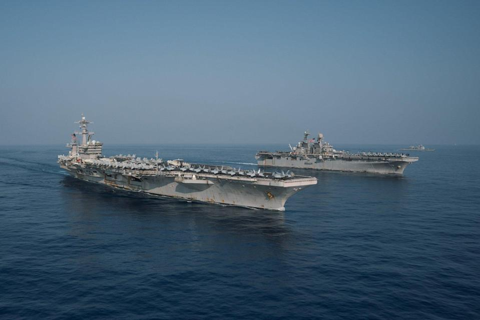 The Theodore Roosevelt Carrier Strike Group transits in formation with the Makin Island Amphibious Ready Group in the South China Sea on April 9, 2021. Photo: Handout
