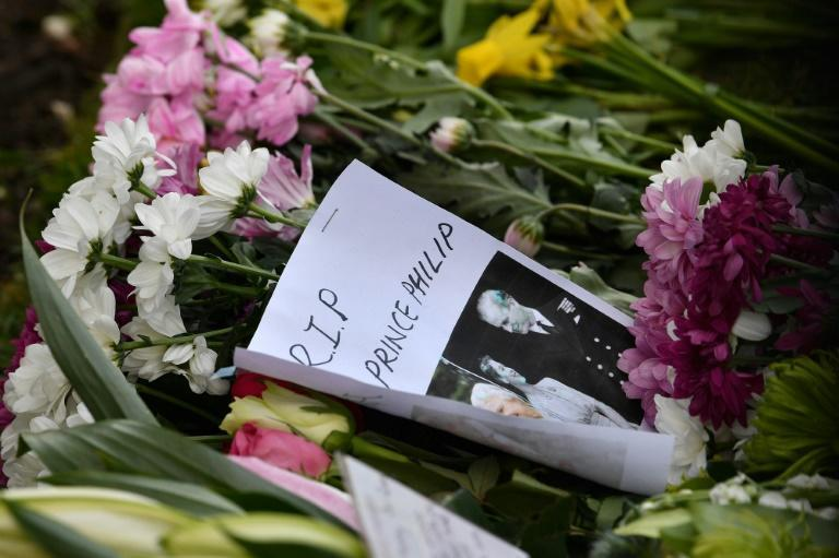 Floral tributes and messages of condolence have been left outside Windsor Castle
