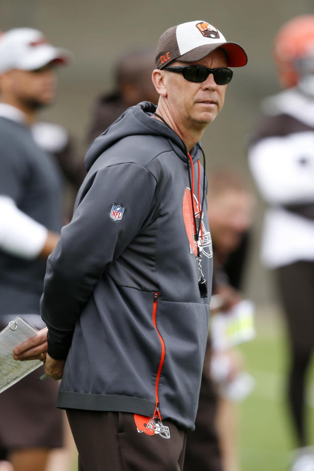 FILE - In this May 22, 2019, file photo, Cleveland Browns offensive coordinator Todd Monken watches a drill during an NFL football organized team activity session at the team's training facility in Berea, Ohio. Todd Monken, the former offensive coordinator for the Cleveland Browns and Tampa Bay Buccaneers, is Kirby Smart's choice to lead Georgia's offense. Monken was named on Friday, Jan. 17, 2020, to replace James Coley as the Bulldogs' offensive coordinator. Coley will remain on staff as assistant head coach.(AP Photo/Ron Schwane, File)