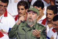 <p>Cuban athletes surround Cuban leader Fidel Castro to sing Happy Birthday in recognition of Castro's 65th birthday in Havana on August 13, 1991. Castro attended the USA/Cuba water polo finals at the Pan Am games. Cuba won 8-5. (AP Photo/Charles Tasnadi) </p>