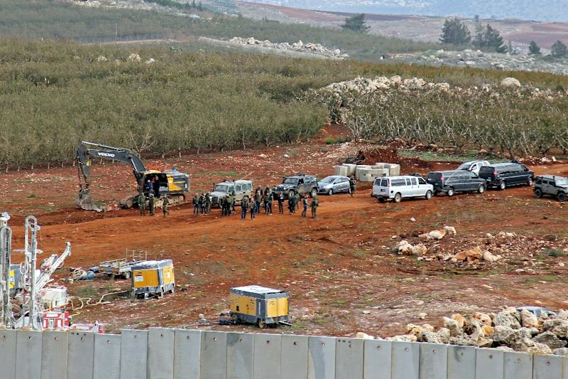 A picture taken on December 5, 2018 from a position near the southern Lebanese village of Kfar Kila shows the Israeli military, excavators, trailers and other vehicles operating on the other side of the border in search of Hezbollah tunnels