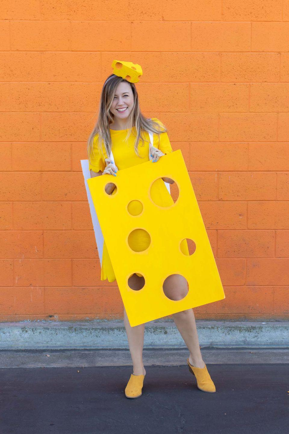 """<p>This easy, cheesy costume is hole-y fun (see what we did there?), but don't forget the yellow shoes!</p><p><strong>Get the tutorial at <a href=""""https://www.clubcrafted.com/cheese-costume-halloween/"""" rel=""""nofollow noopener"""" target=""""_blank"""" data-ylk=""""slk:Club Crafted"""" class=""""link rapid-noclick-resp"""">Club Crafted</a>.</strong></p><p><a class=""""link rapid-noclick-resp"""" href=""""https://www.amazon.com/Silverlake-Craft-Foam-Block-Arrangements/dp/B07TCR8T28/ref=asc_df_B07TCR8T28/?tag=syn-yahoo-20&ascsubtag=%5Bartid%7C10050.g.4571%5Bsrc%7Cyahoo-us"""" rel=""""nofollow noopener"""" target=""""_blank"""" data-ylk=""""slk:SHOP CRAFTING FOAM"""">SHOP CRAFTING FOAM</a><br></p>"""