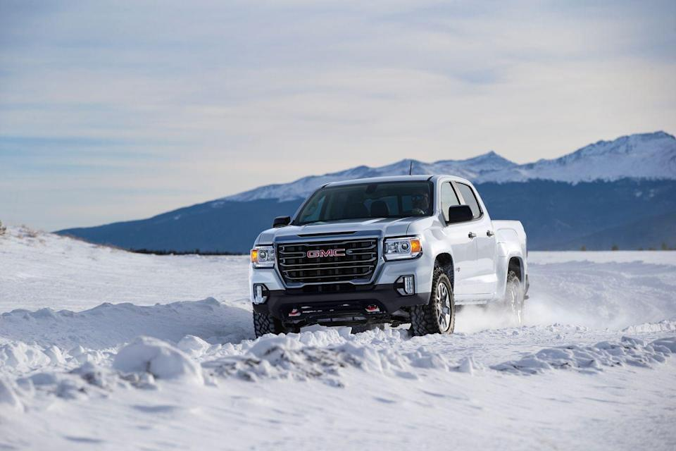 "<p>The <a href=""https://www.caranddriver.com/gmc/canyon"" rel=""nofollow noopener"" target=""_blank"" data-ylk=""slk:2021 GMC Canyon"" class=""link rapid-noclick-resp"">2021 GMC Canyon</a> is essentially the more glamorous version of the <a href=""https://www.caranddriver.com/chevrolet/colorado"" rel=""nofollow noopener"" target=""_blank"" data-ylk=""slk:Chevy Colorado"" class=""link rapid-noclick-resp"">Chevy Colorado</a>, even though they're largely identical underneath the surface. While these mid-size pickup trucks are hugely popular, they're now facing greater competition from alternatives such as the <a href=""https://www.caranddriver.com/ford/ranger"" rel=""nofollow noopener"" target=""_blank"" data-ylk=""slk:Ford Ranger"" class=""link rapid-noclick-resp"">Ford Ranger</a> and <a href=""https://www.caranddriver.com/jeep/gladiator"" rel=""nofollow noopener"" target=""_blank"" data-ylk=""slk:Jeep Gladiator"" class=""link rapid-noclick-resp"">Jeep Gladiator</a>. Unlike every other truck in this class, <a href=""https://www.caranddriver.com/gmc"" rel=""nofollow noopener"" target=""_blank"" data-ylk=""slk:GMC"" class=""link rapid-noclick-resp"">GMC</a> markets its mid-sizer as a premium pickup, even though its top-of-the-line Denali model fails to meet that expectation. Still, the Canyon can be covered in chrome and fitted with fancy features, such as heated and cooled seats. It's also available with a trio of engines that include a strong V-6 and a torque-rich diesel four-cylinder. As with the Colorado, the Canyon offers a surprisingly refined ride and athletic handling for truck that's not based on a crossover. This allows it to best imitate full-size pickups—such as the <a href=""https://www.caranddriver.com/gmc/sierra-1500"" rel=""nofollow noopener"" target=""_blank"" data-ylk=""slk:GMC Sierra 1500"" class=""link rapid-noclick-resp"">GMC Sierra 1500</a>—by way of its tremendous towing and hauling capabilities.</p><p><a class=""link rapid-noclick-resp"" href=""https://www.caranddriver.com/gmc/canyon"" rel=""nofollow noopener"" target=""_blank"" data-ylk=""slk:Review, Pricing, and Specs"">Review, Pricing, and Specs</a></p>"