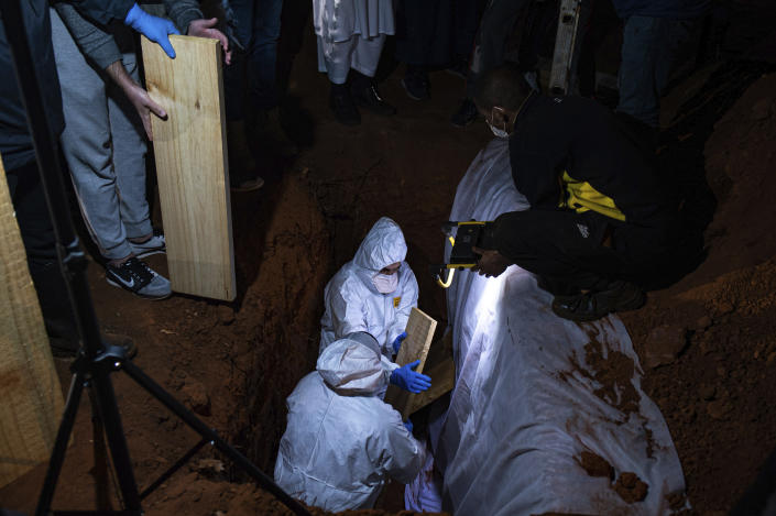 FILE — In this Sunday, June 27, 2021 file photo a Muslim burial of a COVID-19 victim takes place at the Westpark Cemetery in Johannesburg. Driven by the delta variant, a new wave of COVID-19 is sweeping across the African continent where new cases, hospital admissions, and deaths are increasing. (AP Photo/Ali Greeff)
