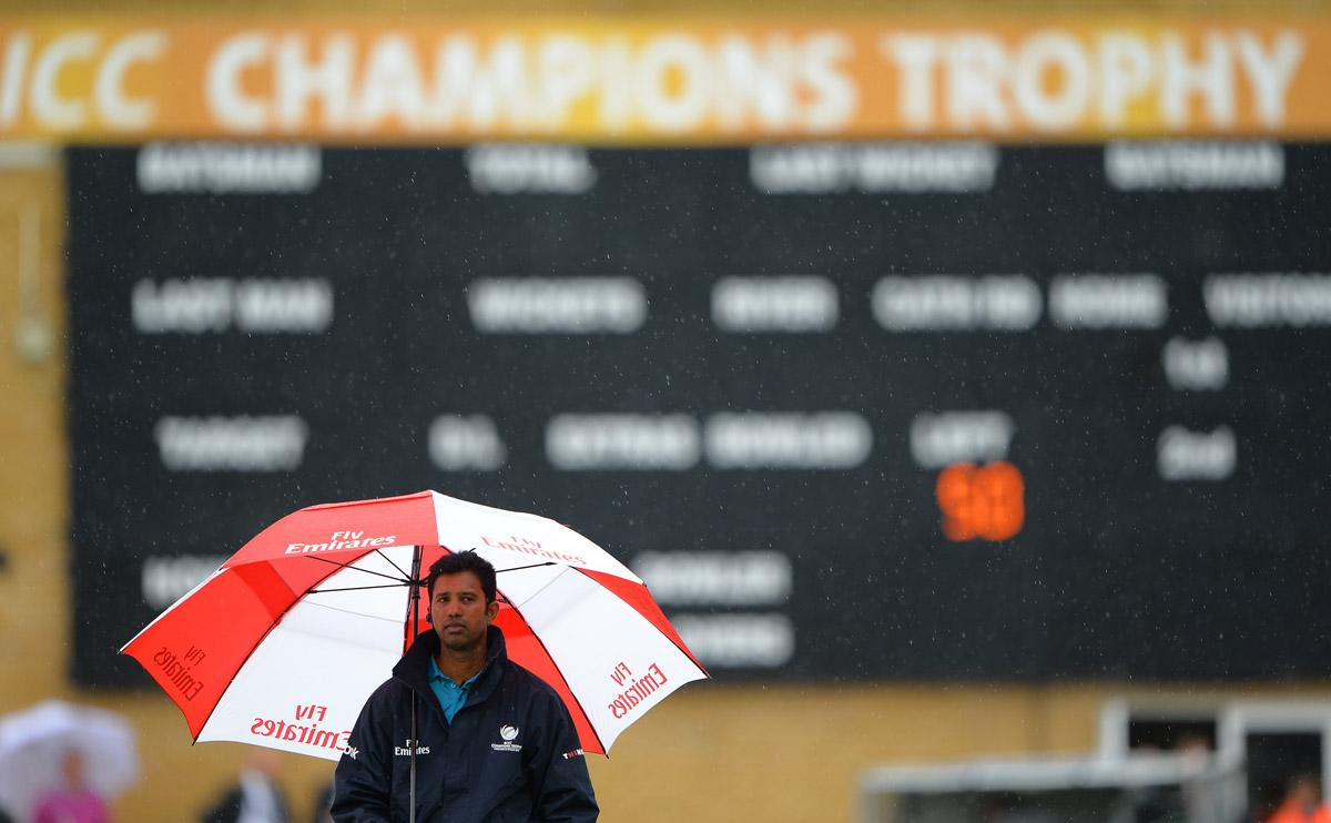 Rain delays the start of the 2013 ICC Champions Trophy cricket match between England and New Zealand at the Cardiff Wales Stadium in Cardiff, south Wales on June 16, 2013. AFP PHOTO/ANDREW YATES --  RESTRICTED TO EDITORIAL USE        (Photo credit should read ANDREW YATES/AFP/Getty Images)
