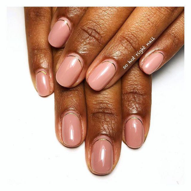 """<p>Mix up your traditional glossy pink manicure with a curve of gold metallic polish just above your cuticle.</p><p><a href=""""https://www.instagram.com/p/BpcUsRSgvbu/"""" rel=""""nofollow noopener"""" target=""""_blank"""" data-ylk=""""slk:See the original post on Instagram"""" class=""""link rapid-noclick-resp"""">See the original post on Instagram</a></p>"""