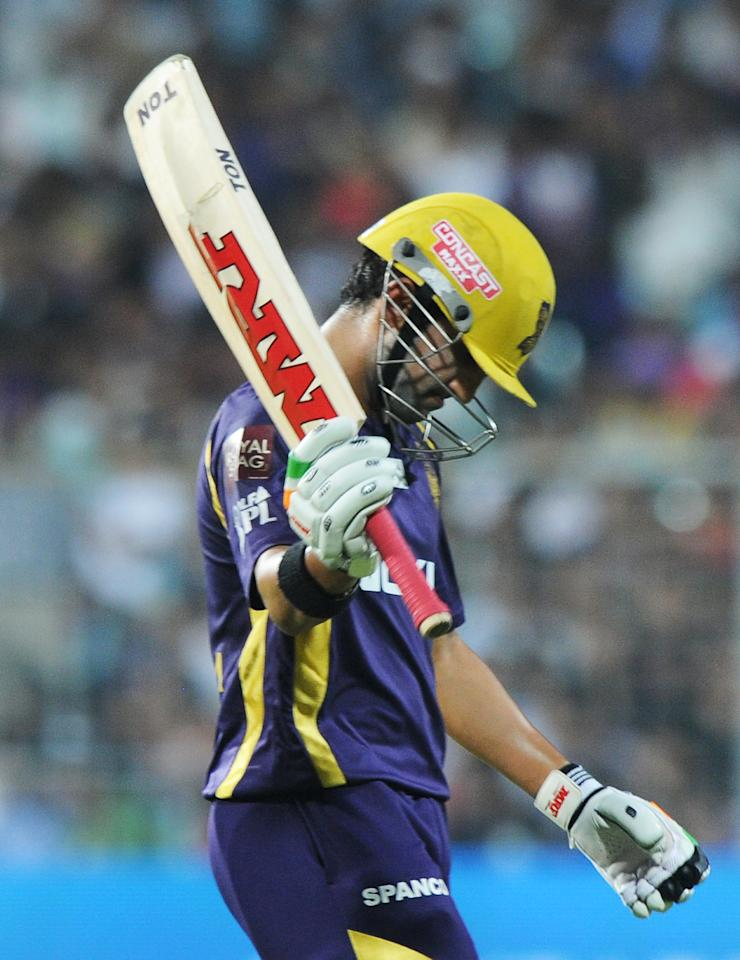 Kolkata Knight Riders captain Gautam Gambhir reacts after losing his wicket during the IPL Twenty20 cricket match between Kolkata Knight Riders and Kings XI Punjab at The Eden Gardens in Kolkata on April 15, 2012. RESTRICTED TO EDITORIAL USE. MOBILE USE WITHIN NEWS PACKAGE. AFP PHOTO/Dibyangshu SARKAR (Photo credit should read DIBYANGSHU SARKAR/AFP/Getty Images)