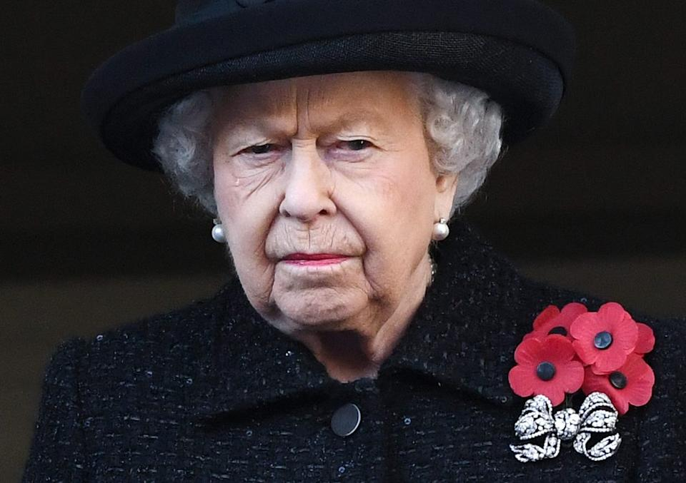 The Queen appears to shed a tear whilst attending the National Service of Remembrance at the Cenotaph, Whitehall, London. (Doug Peters/EMPICS)