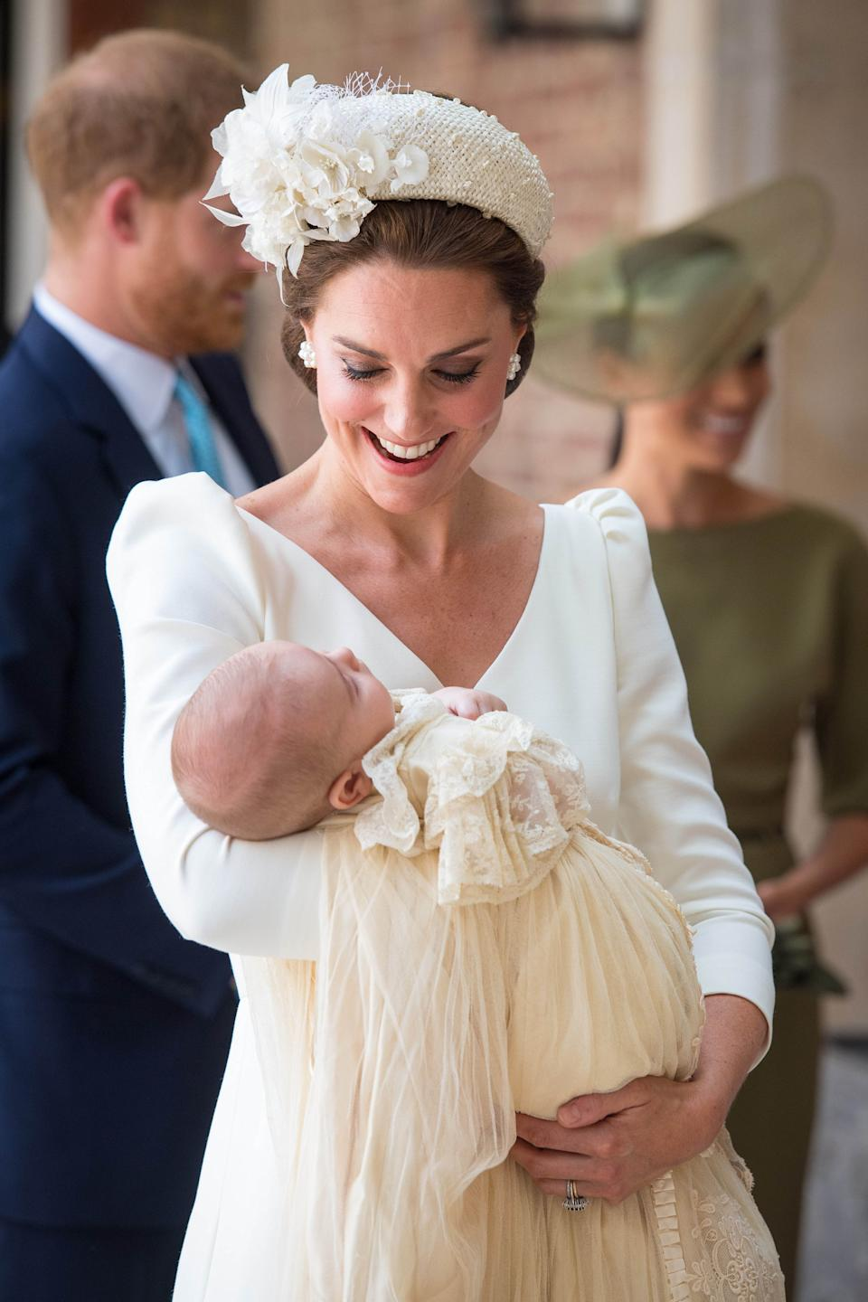 The Duchess of Cambridge carries Prince Louis as they arrive for his christening service at the Chapel Royal, St James's Palace, London.