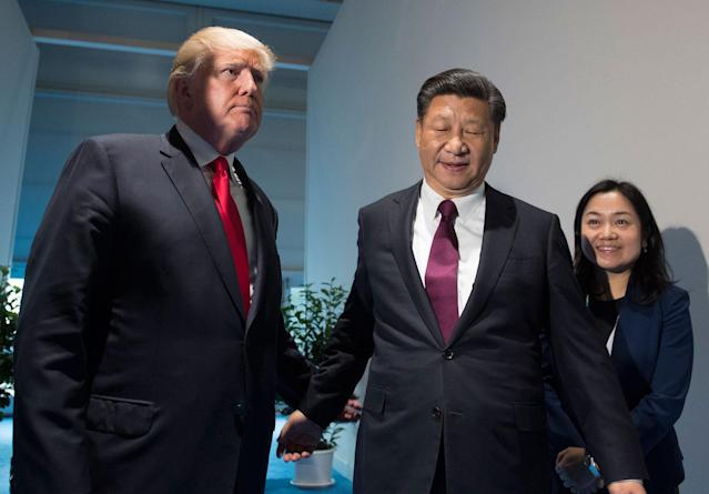 <p>President Donald Trump and Chinese President Xi Jinping, right, arrive for a meeting on the sidelines of the G-20 Summit in Hamburg, Germany, Saturday, July 8, 2017. (Photo: Saul Loeb/Pool Photo via AP) </p>