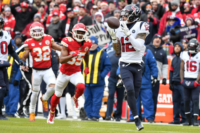 Houston Texans wide receiver Kenny Stills (12) makes a touchdown catch during the first half of an NFL divisional playoff football game against the Kansas City Chiefs, in Kansas City, Mo., Sunday, Jan. 12, 2020. (AP Photo/Ed Zurga)