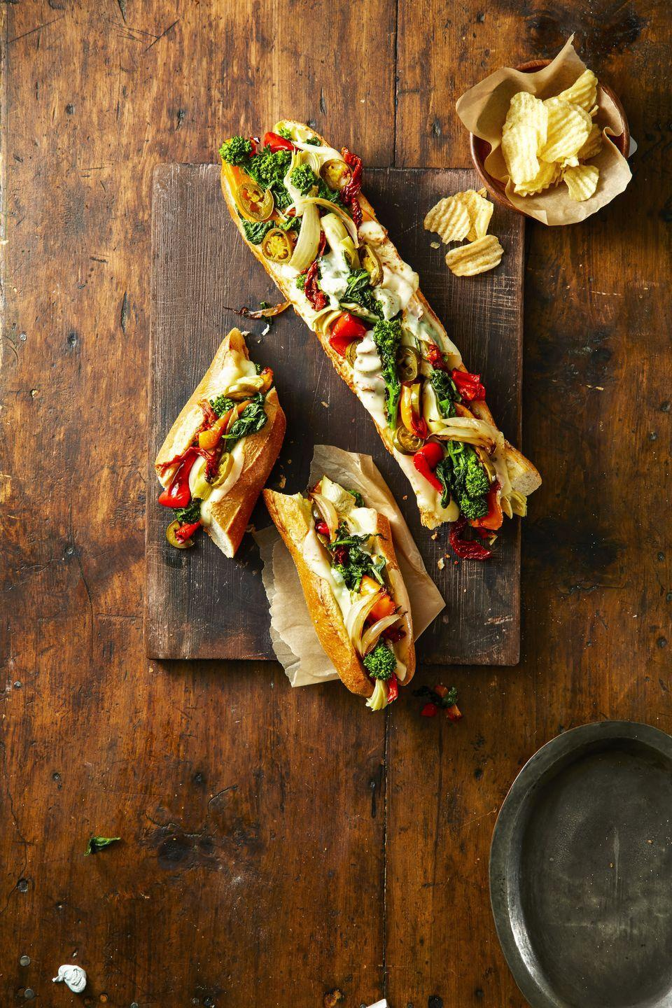 """<p>These party-friendly sandwiches are fully loaded with tons of cheese and veggies that guests won't even miss the meat. </p><p><em><a href=""""https://www.goodhousekeeping.com/food-recipes/a42217/provolone-veggie-party-subs-recipe/"""" rel=""""nofollow noopener"""" target=""""_blank"""" data-ylk=""""slk:Get the recipe for Provolone Veggie Party Subs »"""" class=""""link rapid-noclick-resp""""><span class=""""redactor-invisible-space""""><span class=""""redactor-invisible-space""""><em>Get the recipe for Provolone Veggie Party Subs »</em></span></span></a></em><br></p>"""