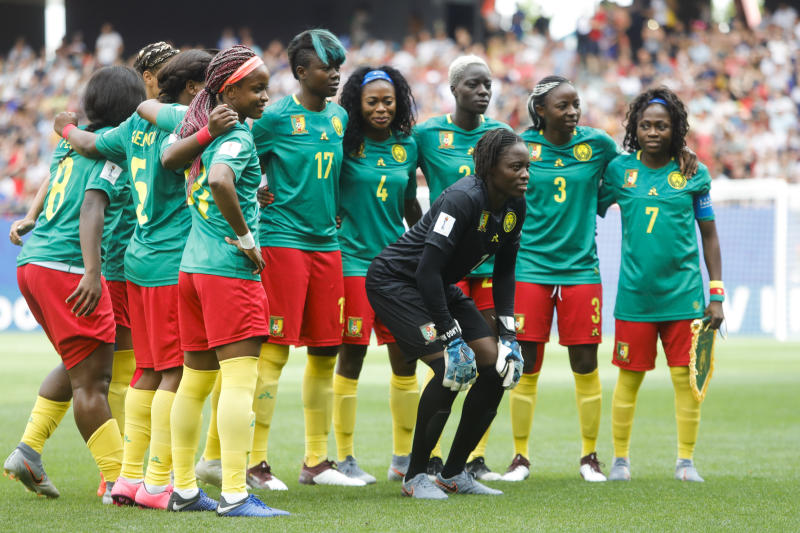 Cameroon players pose for an official photo before the start of the Women's World Cup round of 16 soccer match between England and Cameroon at the Stade du Hainaut stadium in Valenciennes, France, Sunday, June 23, 2019. (AP Photo/Michel Spingler)