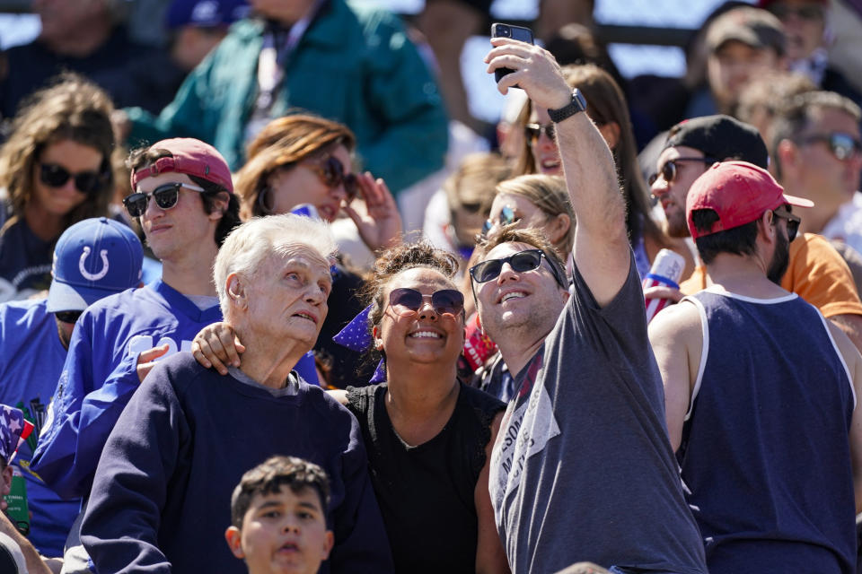 Fans take a photo before the Indianapolis 500 auto race at Indianapolis Motor Speedway in Indianapolis, Sunday, May 30, 2021. (AP Photo/Darron Cummings)