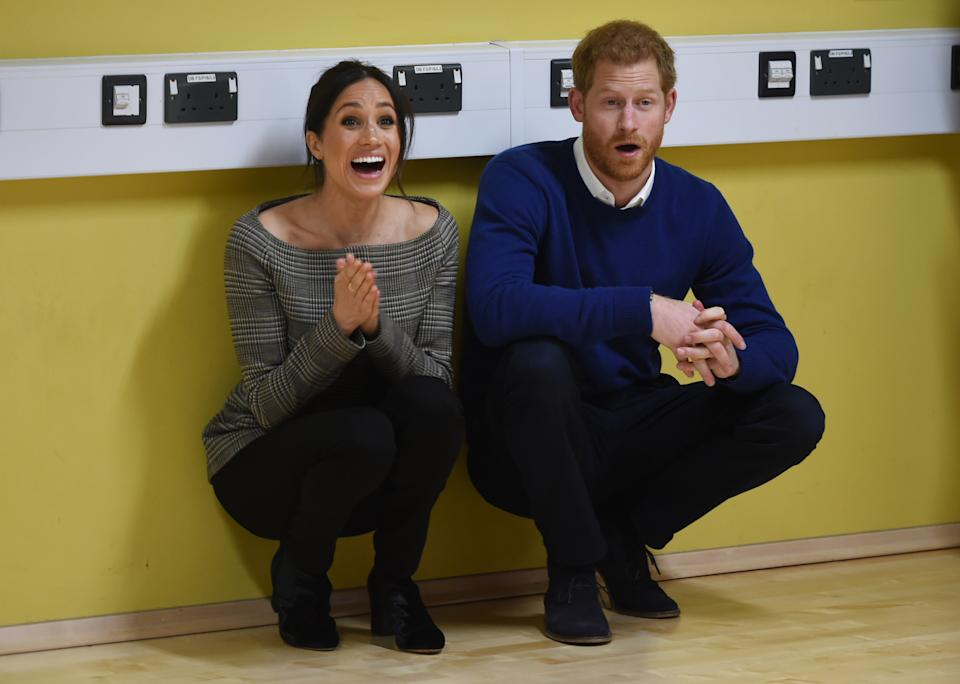 Britain's Prince Harry and Meghan Markle attend a street dance class during their visit to Star Hub community and leisure centre in the Tremorfa area of Cardiff, south Wales