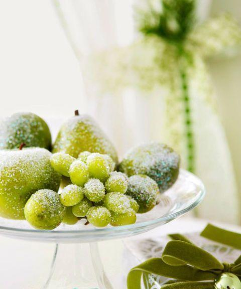 "<p>Fake an icy frost with this wintry recipe: Mix three parts white glitter to one part silver. Then coat faux pears, limes, and grapes for a sparkly centerpiece.</p><p>See more at <a href=""http://www.goodhousekeeping.com/holidays/christmas-ideas/how-to/g2203/christmas-decoration-ideas/"" rel=""nofollow noopener"" target=""_blank"" data-ylk=""slk:Good Housekeeping"" class=""link rapid-noclick-resp"">Good Housekeeping</a>. </p>"