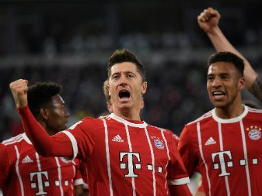 Robert Lewandowski converted a 91st-minute penalty to rescue Bundesliga leaders Bayern Munich with a 2-1 win at Wolfsburg on Saturday which took their winning streak to 13 and extended their advantage at the top of the table to 21 points.