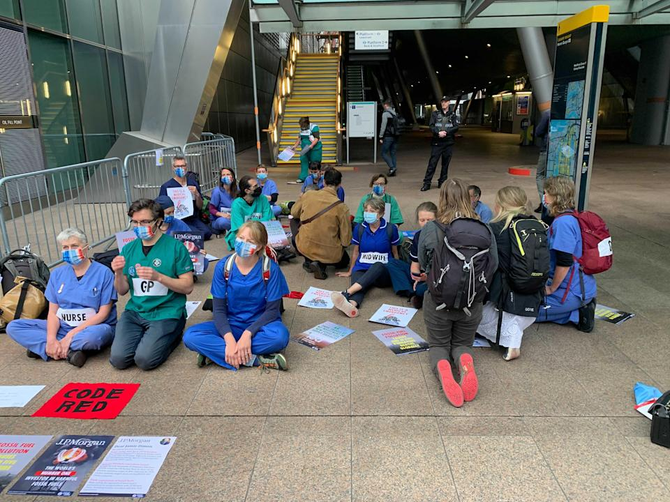 Protesters gathered outside a DLR station close to the bank's HQ (The Independent)