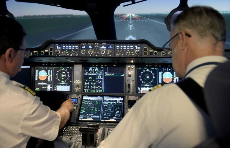 It looks and feels completely real but here two Air France pilots prepare for take-off on a flight simulator, used by airlines to keep their crews up to standard during the pandemic