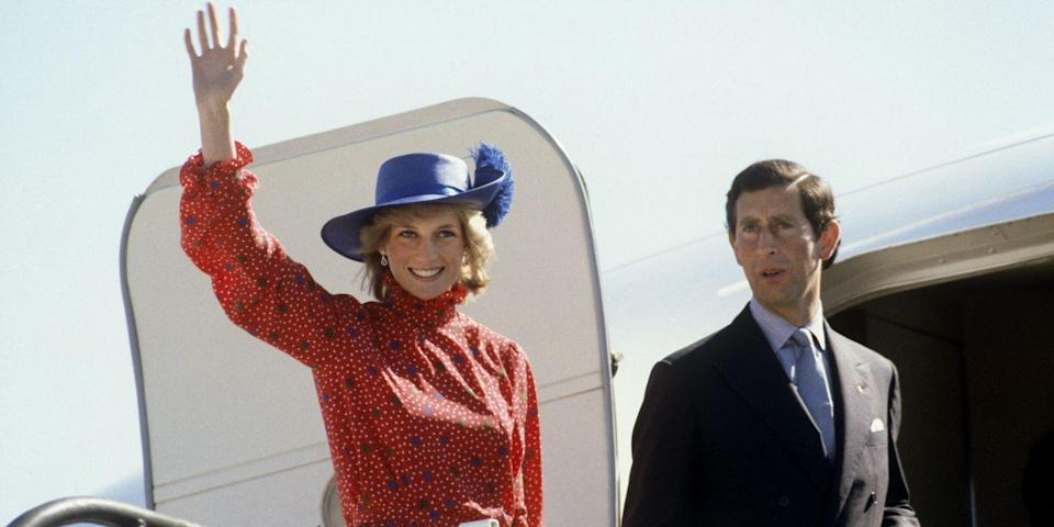 <p>Dressed in a blue hat and red printed dress, Diana waves goodbye as she and Charles board the plane to leave Melbourne. </p>