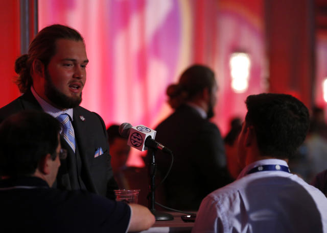 Texas A&M NCAA college football player Koda Martin speaks during the Southeastern Conference's annual media gathering, Wednesday, July 12, 2017, in Hoover, Ala. (AP Photo/Butch Dill)