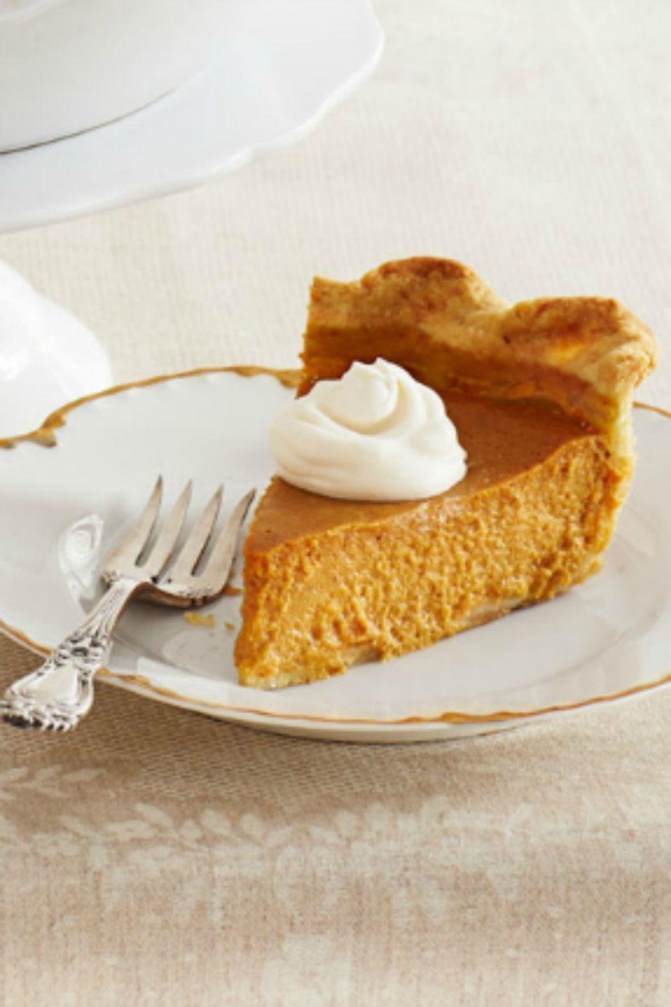 "<p>You can't go wrong with a classic <a href=""https://www.womansday.com/food-recipes/food-drinks/g1965/pumpkin-pie-recipes/"" rel=""nofollow noopener"" target=""_blank"" data-ylk=""slk:pumpkin pie recipe"" class=""link rapid-noclick-resp"">pumpkin pie recipe</a> — especially when it's paired with a rum-infused whipped cream. </p><p><strong><em><a href=""https://www.womansday.com/food-recipes/food-drinks/recipes/a39323/ultimate-pumpkin-pie-rum-whipped-cream-recipe-ghk1113/"" rel=""nofollow noopener"" target=""_blank"" data-ylk=""slk:Get the Pumpkin Pie with Rum Whipped Cream recipe."" class=""link rapid-noclick-resp"">Get the Pumpkin Pie with Rum Whipped Cream recipe. </a></em></strong></p>"