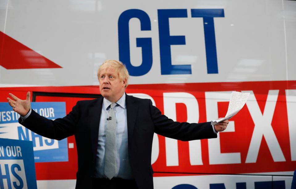 Britain's Prime Minister Boris Johnson addresses supporters as he unveils the Conservative party General Election campaign bus in Manchester, northwest England on November 15, 2019. (Photo by Frank Augstein / POOL / AFP) (Photo by FRANK AUGSTEIN/POOL/AFP via Getty Images)