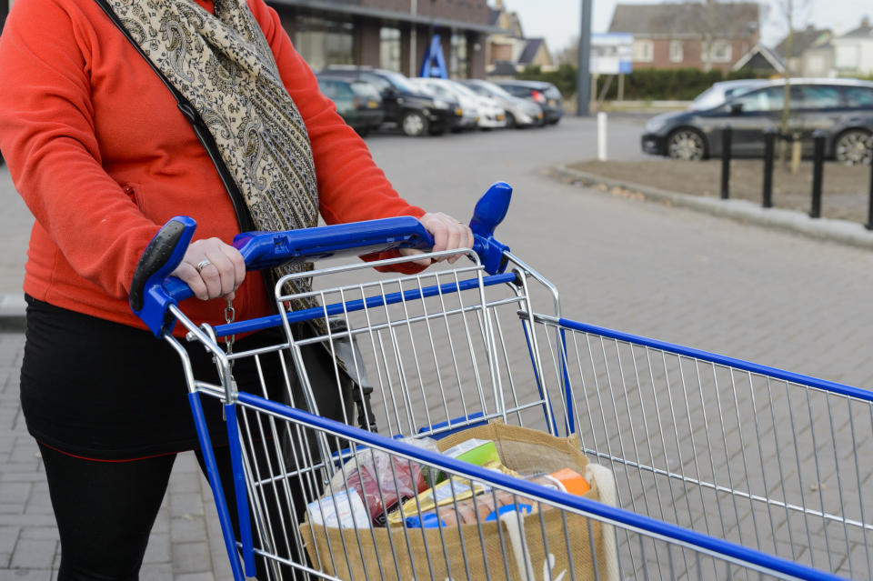 Woman standing with Aldi trolley. Source: Getty Images