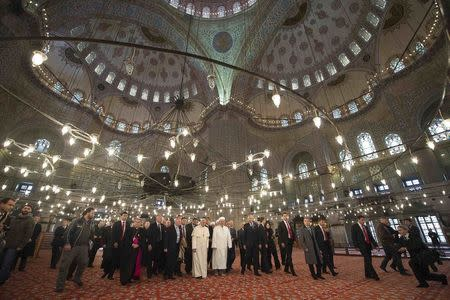 Pope Francis is shown the Sultan Ahmet mosque, popularly known as the Blue Mosque, by Mufti of Istanbul, Rahmi Yaran, during his visit to Istanbul November 29, 2014.  REUTERS/Osservatore Romano