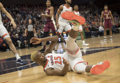 Virginia foreword Mamadi Diakite hits the floor after drawing a charge against Florida State during the first half of an NCAA college basketball game in Charlottesville, Va., Tuesday, Jan. 28, 2020. (AP Photo/Lee Luther Jr.)