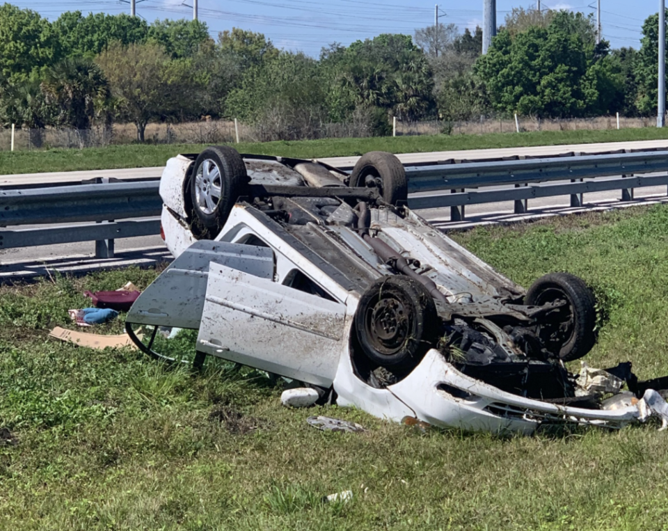 A crashed car, overturned, is seen in Florida.