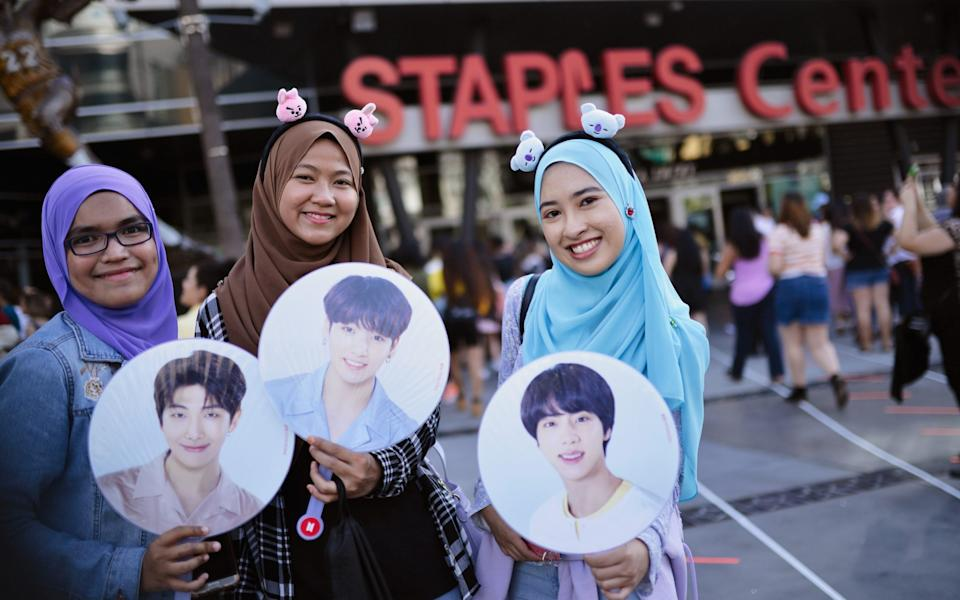 BTS fans wait outside the BTS concert at the Staples Centre in Los Angeles