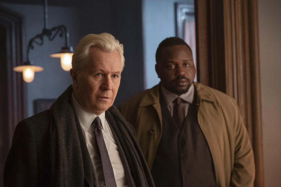 """This image released by Netflix shows Gary Oldman, left, and Brian Tyree Henry in a scene from """"The Woman in the Window."""" (Melinda Sue Gordon/Netflix via AP)"""