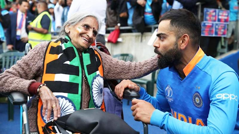 Indian cricket superfan Charulata Patel, pictured with India's captain Virat Kohli, has died, aged 87. Picture: Twitter/@RCBTweets