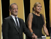Vincent Lindon, left, and director Julia Ducournau accept the Palme d'Or for the film 'Titane' during the awards ceremony for the 74th international film festival, Cannes, southern France, Saturday, July 17, 2021. (AP Photo/Vadim Ghirda)
