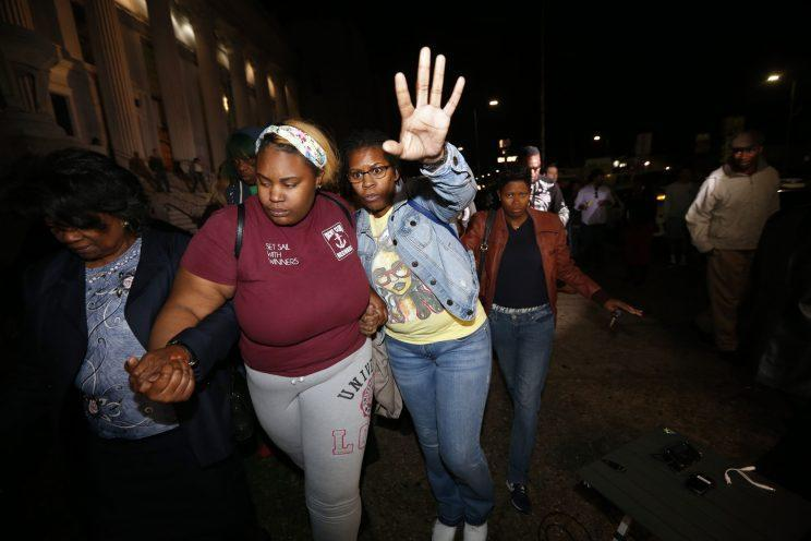 Supporters of Cardell Hayes leave the courthouse Sunday night. (AP)