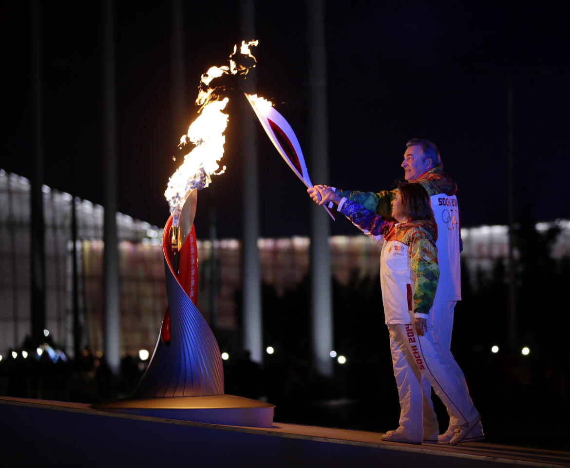 Irina Rodnina and Vladislav Tretiak light the Olympic cauldron during the opening ceremony of the 2014 Winter Olympics in Sochi, Russia, Friday, Feb. 7, 2014. (AP Photo/Matt Slocum, Pool)