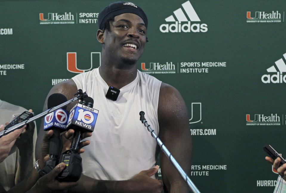 FILE - Miami NCAA college football defensive linemen Gregory Rousseau talks to the media after practice at the University of Miami Greentree Practice Field in Coral Gables, Fla., in this Tuesday, Sept. 10, 2019, file photo. Rousseau is a possible first round pick in the NFL Draft, April 29-May 1, 2021, in Cleveland. (David Santiago/Miami Herald via AP, File)
