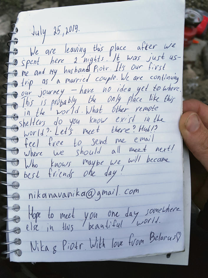 """This undated photo provided by Piotr Markielau shows a handwritten note he and his wife Veranika Nikonova left in an abandoned bus in the Alaska wilderness before she died on July 25, 2019, following her struggle to cross the Teklanika River. Markielau said he frantically tried but failed to save his wife as she struggled to cross the river near a bus in the Alaska wilderness made famous by the movie """"Into the Wild."""" (Piotr Markielau via AP)"""