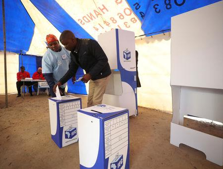 A voter casts his ballot at a polling station during the South Africa'sÊparliamentary and provincial elections, in Alexandra township, Johannesburg, South Africa, May 8, 2019. REUTERS/Mike Hutchings