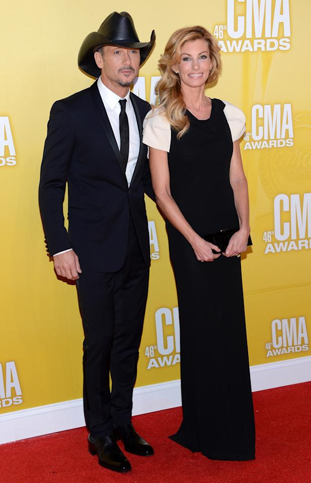 "<p class=""MsoNormal""><span style=""color:black;"">One of Nashville's royal couples, Tim McGraw and Faith Hill, looked sleek and sophisticated in their black-and-white ensembles. But why isn't Tim smiling? He was already a winner before the night got started! The 45-year-old singer won an award in the musical event category for his collaboration with Kenny Chesney on ""Feel Like a Rock Star."" (11/1/2012)<br></span></p>  ."
