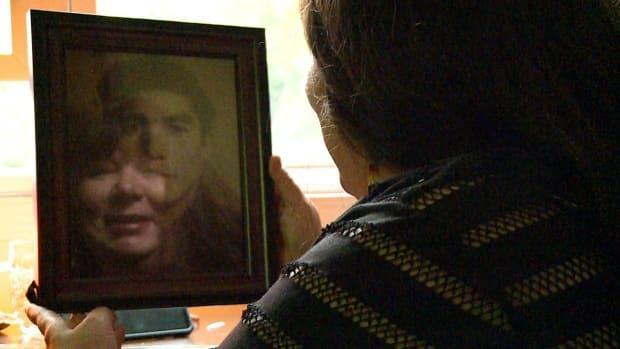 Jilayne Davidson holds a photo of Mervin Sinclair, who was last seen in 1958. His cold case may soon be solved — after Davidson took a DNA test and discovered Sinclair may have been living under an assumed name until his death. (Helen Pike/CBC - image credit)