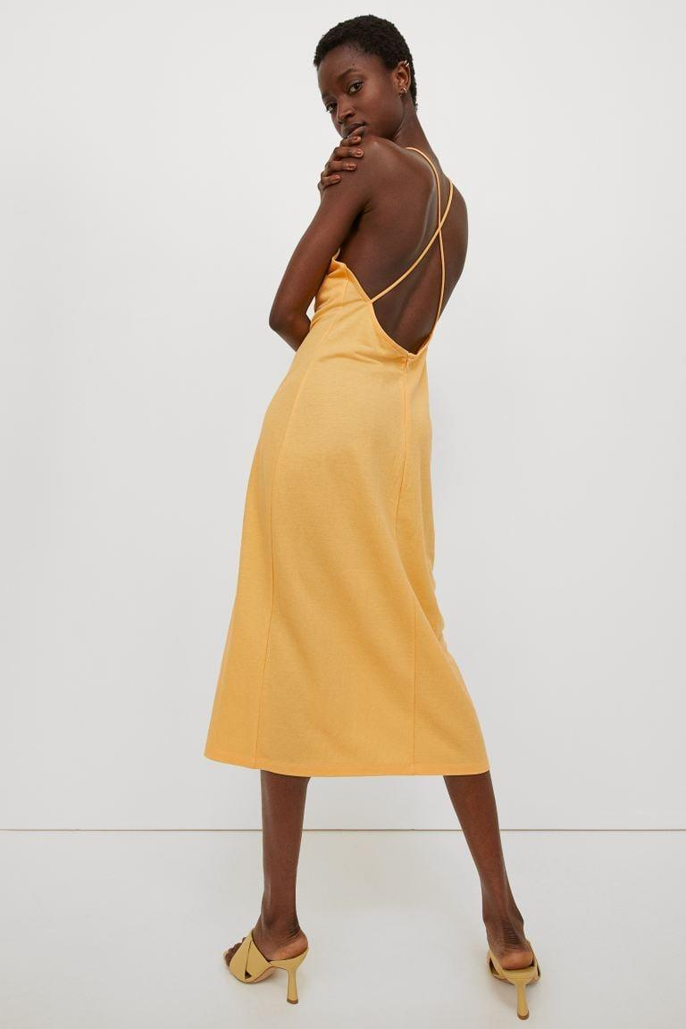 <p>Headed to a fun dinner? Then you'll want the <span>H&amp;M Calf-length Dress</span> ($50). The flattering silhouette would look good with heels, sandals, sneakers . . . you name it. It also comes in black and beige too. </p>