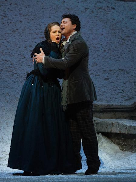 """In this photo provided by the Metropolitan Opera, Vittorio Grigolo plays Rodolfo with Kristine Opolais as Mimi in the Metropolitan Opera's Live in HD broadcast of Puccini's """"La Boheme,"""" Saturday, April 5, 2014 in New York. Opolais made Metropolitan Opera history Saturday, stepping in for an ailing soprano to make her second company role debut in a span of 24 hours. On Friday night, Opolais sang Cio-Cio-San in Puccini's """"Madama Butterfly."""" (AP Photo/Metropolitan Opera, Marty Sohl)"""